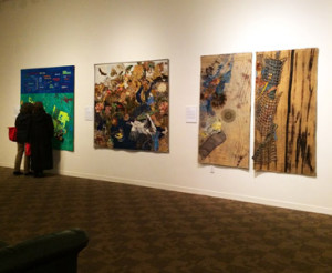 Earth Stories installation view, textile and fiber works by members of Studio Art Quilt Associates. The quilts pictured here (L to R) are by Alicia Merrett, Annie Helmericks-Louder, and Marilyn M. Prucka.