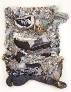 Harriet Cherry Cheney, Gray Areas, 2016, 29 x 24 x 4.5 in.; bath mat, fabric, beads, handmade paper and paper beads, wood, yarn, metal hooks, wood, Danish coaster.